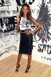 Jasmine Tookes amped up the chic factor with a stud-and-chain-embellished leather skirt.