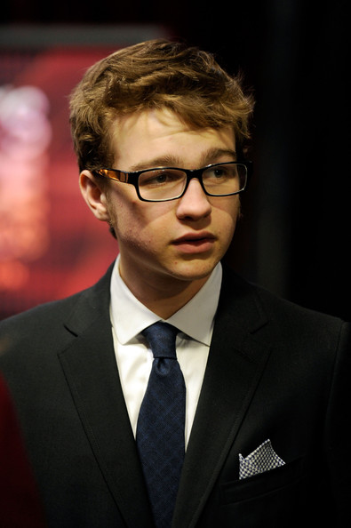 Angus T. Jones Messy Cut [vision care,eyewear,glasses,suit,gentleman,formal wear,official,sunglasses,businessperson,tuxedo,peoples choice awards,california,los angeles,nokia theatre l.a. live,angus t. jones,audience]