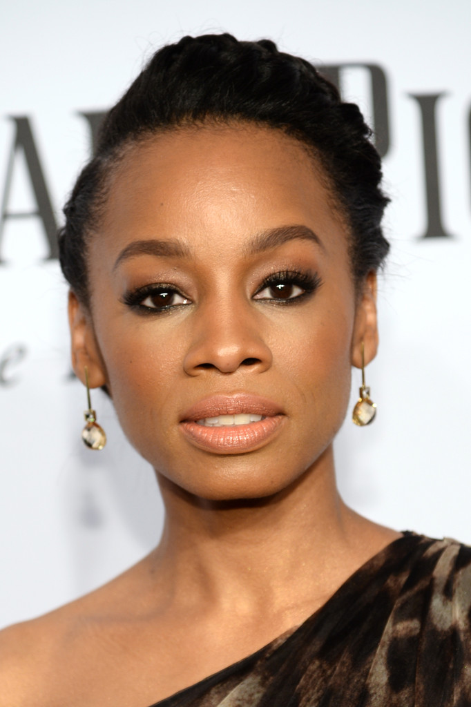 Anika Noni Rose swept her hair up into a side-parted crown braid for the