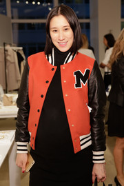 Eva Chen showed off her cool maternity style with this red and black leather-sleeve varsity jacket by Moschino at the Ann Taylor presentation.