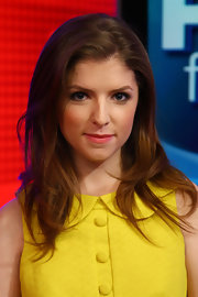 Anna Kendrick wore a pretty coral-pink lipstick while visiting 'FOX & Friends'. She chose a full-coverage lipstick with minimal shine. To try her look at home, we recommend a product like Covergirl LipPerfection Lipcolor in Heavenly.