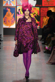 Belle Hadid looked opulent in a purple jacquard coat while walking the Anna Sui show.