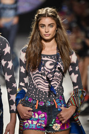 A pair of graffiti-print jean shorts completed Taylor Hill's eclectic look.