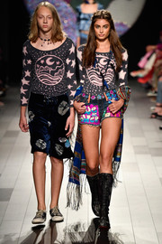 Taylor Hill was a hippie babe in black lace-up boots, jean shorts, and a graphic top at the Anna Sui runway show.