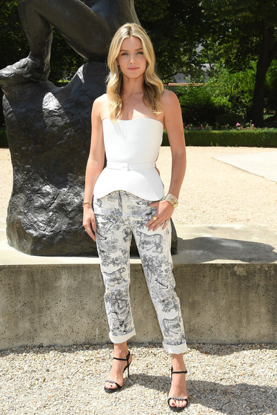 Annabelle Wallis Tube Top [clothing,white,jeans,fashion,lady,street fashion,waist,leg,footwear,blond,christian dior,annabelle wallis,part,paris,france,christian dior haute couture fall winter 2018,photocall - paris fashion week,show,paris fashion week]