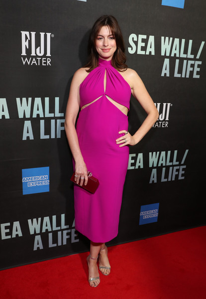 Anne Hathaway Evening Sandals [dress,clothing,cocktail dress,shoulder,carpet,red carpet,premiere,pink,fashion model,hairstyle,fiji water,anne hathaway,sea wall,new york city,a life opening night on broadway]