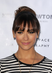 Rashida pinned back her hair into a twisted bun to showcase her thick and choppy bangs.