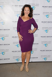 Fran Drescher showed off her curves in this fitted plum dress.