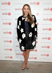 Harley Viera-Newton looked both fun and chic in a black-and-white floral fur coat by Prada at the Annie for Target launch.