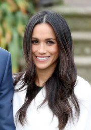 A beaming Meghan Markle looked oh-so-lovely with her long wavy 'do during the announcement of her engagement to Prince Harry.