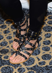 Justine matched the studs on her leather jacket to the studs on these strappy, gladiator sandals.