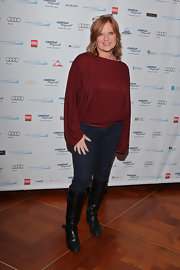 Caroline Manzo went for a youthful vibe with a loose maroon blouse, jeans, and knee-high boots at the Cantor Fitzgerald Charity Day.