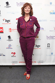 Susan Sarandon may have kept her look all in the purple category, but she added some extra spice to it with this print blouse.