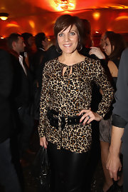 Birgit Schrowange attended Lambertz Monday Night looking fierce in a leopard-print blouse.
