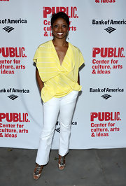 Montego Glover's sunshine yellow loose blouse featured cool nautical white stripes.