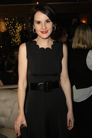 Michelle Dockery paired an oversized belt with a scalloped LBD for the HBO Golden Globes event.