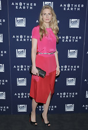 Brit Marling was right on trend in a neon color-blocked silk frock. The blonde opted to wear black heels and a clutch to complete her look.
