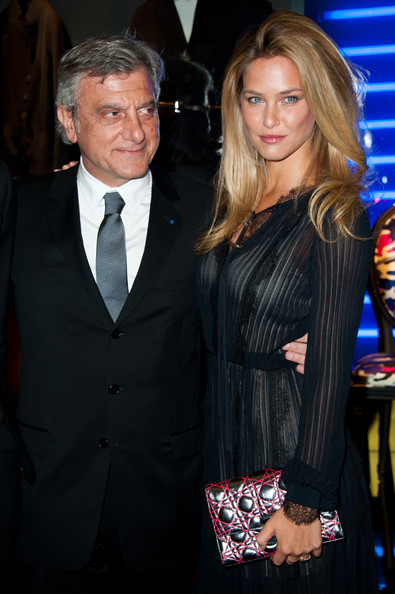 Bar Refaeli accented her sexy sheer gown with a modern pewter and red quilted clutch.