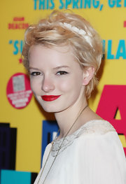 Dakota Blue Richards gave her natural beauty a boost with vivid red lipstick.