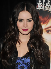 Lily Collins promoted her film 'Mirror Mirror' wearing a rich boysenberry shade of lipstick.