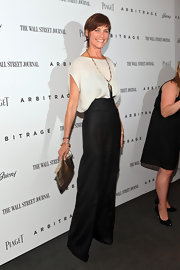 Carey Lowell showed off her leggy physique in black high-waisted pants at the New York premiere of 'Arbitrage.'