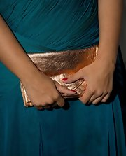 Leonna Lewis carried this soft bronze clutch to the Ariella Couture fashion show.