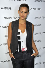 Bar Refaeli paired her pinstripe pants with a matching vest at the Fashion's Night Out celebration.