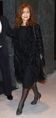 Isabelle Huppert matched lace pumps with her LBD and fringed coat at the Armani Hotel Milano opening.