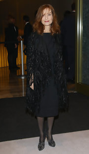 Isabelle Huppert dressed up her simple LBD with a fringed black evening coat at the Armani Hotel Milano opening.