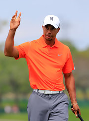 Tiger Woods showed he wasn't afraid of a little color when he sported this tangerine top.