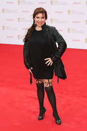 To give her look a little bit of a rocker edge, Tina Malone chose a black leather coat.