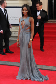 Naomi Campbell oozed sexy glamour at the Arqiva British Academy Television Awards in a gray Roberto Cavalli gown with multiple cutouts on the bodice.