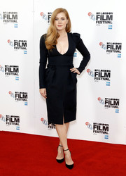 Amy Adams showed major cleavage in this little black dress by Alexander McQueen at the BFI London Film Festival photocall for 'Arrival.'