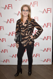 Meryl Streep paired a tiger-print wrap top with black skinny pants for the AFI Awards.