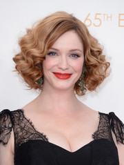 Christina styled her short ginger locks with voluminous curls.