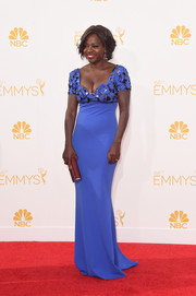 Viola Davis flaunted her cleavage and figure in a vibrant blue-violet Escada gown during the Emmys.