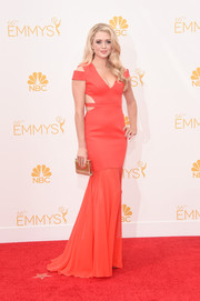 Brooke Newton turned up the heat at the Emmys in a red mermaid gown with bondage-style cutouts.