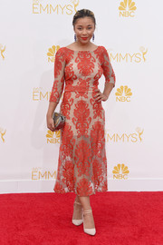 Zoe Soul was chic and classy at the Emmys in a red and nude rococo-patterned cocktail dress.