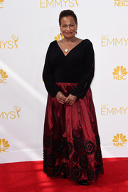 Michelle Hurst chose a long-sleeve red and black evening dress for her Emmys look.