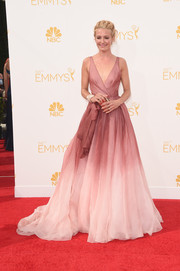 Cat Deeley charmed at the Emmys in an ombre Burberry gown featuring a wrap-style bodice and a voluminous skirt.