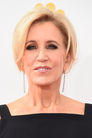 Felicity Huffman attended the Emmys wearing her hair in a low chignon.