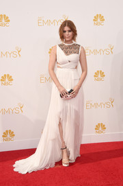 Kate Mara went for a goddess-with-an-edge feel at the Emmys in a white J. Mendel gown featuring a lacy yoke, midriff peekaboo detailing, and a high-low hem.