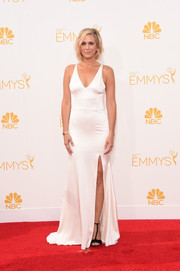 Kristen Wiig was sultry yet elegant at the Emmys in a low-cut, high-slit white gown by Vera Wang.