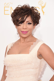 Selenis Leyva pulled off this disheveled 'do at the Emmys.