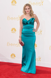 Madeline Brewer worked the Emmys red carpet in a teal Theia strapless gown featuring fold accents along the neckline.