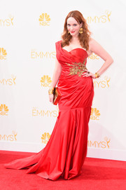 Christina Hendricks set the Emmys red carpet on fire in a red Marchesa one-shoulder gown that perfectly hugged her voluptuous figure.