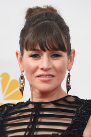 Yael Stone attended the Emmys wearing her hair in a funky bun.