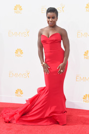 Uzo Aduba worked it on the Emmys red carpet in a stunning red Christian Siriano strapless gown with a flirty ruffle train.