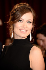 To top off her Audrey Hepburn retro look, Olivia Wilde chose a modern beehive updo with soft tendrils.