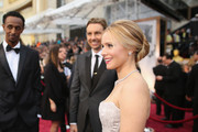 Kristen Bell hit the Oscars red carpet with her hair styled in a classic bun.